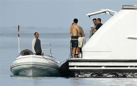 on a boat with a tiger tiger woods reportedly docks 20 million yacht in htons