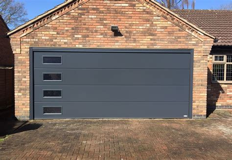 Sectional Overhead Garage Door Steel Aluminum And Wood Sectional Garage Doors Allstateloghomes