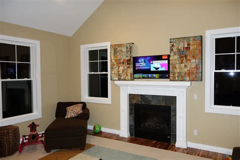Pop Up Tv That Hides In The Fireplace by Think This Is Just A Normal Painting Wrong Prepare To Be
