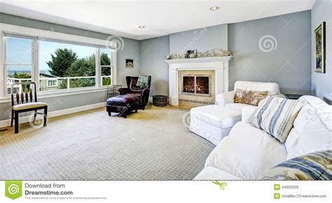 blue room with white furniture light blue living room with white sofa and fireplace stock photo image 44652028