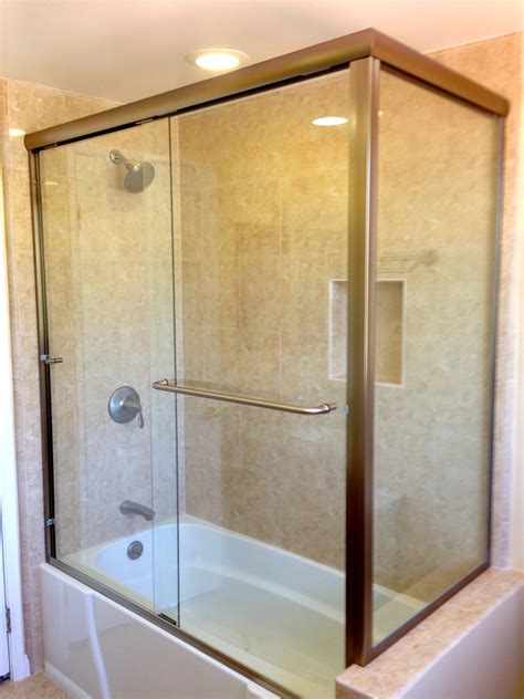 bathtub shower enclosure sliding glass door combined with white tub placed on the