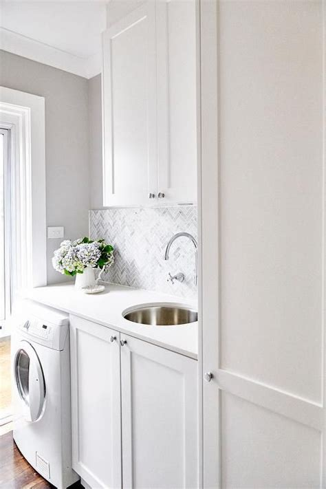 small laundry room cabinets 25 best ideas about small laundry on utility