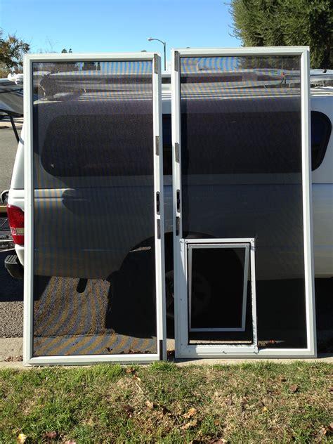 screen door with door built in sliding screen door with pet door built in jacobhursh
