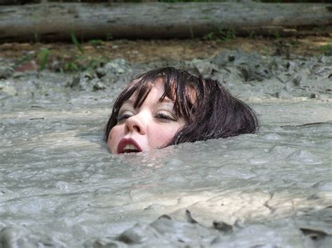 quicksand girl sinking 28 girls sinking in deep mud from downloaddreams a