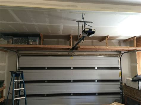 overhead garage door storage 25 best ideas about overhead garage storage on