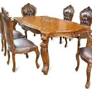 Meja Makan Ganesa set meja makan ukiran ganesa jepara safitri jati furniture