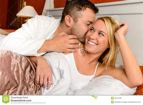 bed man happy couple bed man giving kiss woman stock photos