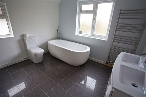 bathtub floor fab oval tub over grey ceramic floor tiled and double