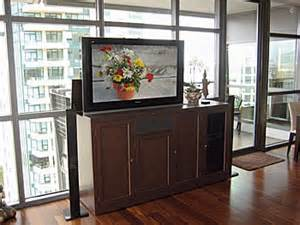 putting a tv in front of a window tv lift cabinets furniture to organize and hide your