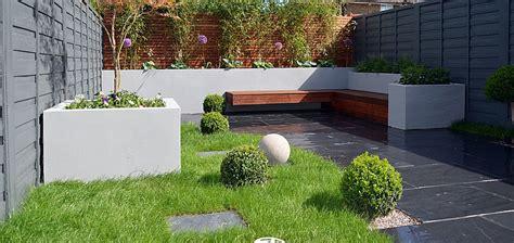 multi level linear garden hertfordshire designed by kate rendered block walls slate paving designer lawn modern