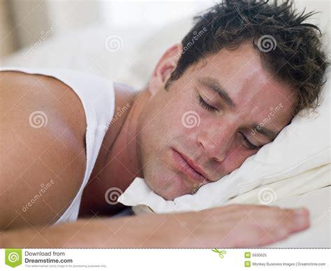 man lying  bed sleeping stock image image  laying