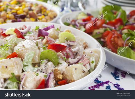 Potato Salad Decoration by Assortment Salads On Buffet Table Stock Photo