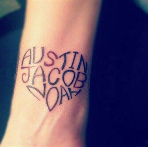 love tattoo with name name tattoo maybe could do this with first and middle name