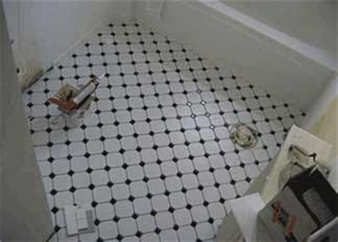 how to remove floor tiles in bathroom removing bathroom floor tile