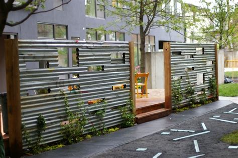 corrugated steel fence with playful cut outs hardscaping privacy screens fences woodwork