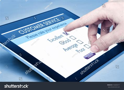 Online Survey Services - online customer service satisfaction survey on a digital tablet stock photo 102605417
