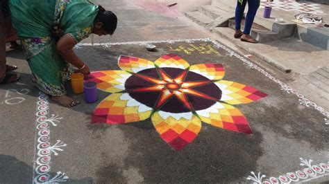 india competition volunteers become judges of a kolam competition in india