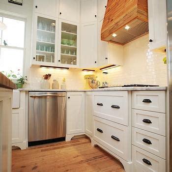 white kitchen bronze hardware under cabinet tv transitional kitchen christina