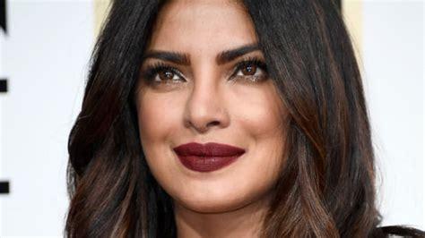 priyanka chopra golden globe awards 2018 best celebrity makeup looks orange eyeshadow bold brows