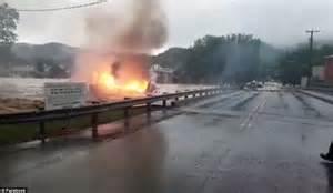 West Virginia Burning by West Virginia Floods Sweep Burning House Away In
