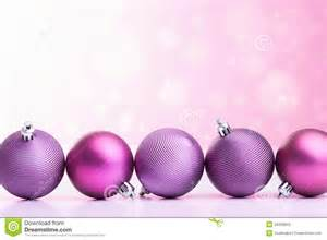 Purple christmas balls over blurred background stock