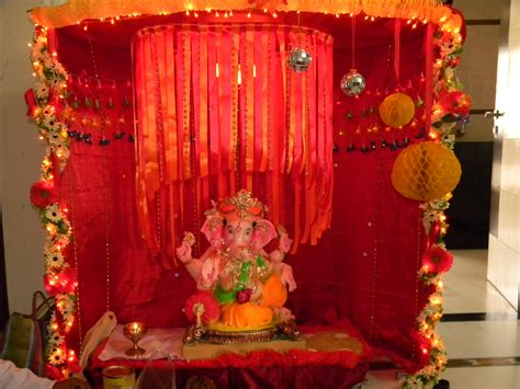 home decoration of ganesh festival mirror balls honeycomb balls and flower decor on my