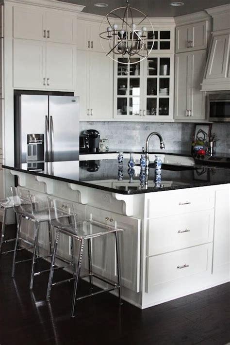 white kitchen cabinets black countertops black granite countertops and white shaker style ceiling