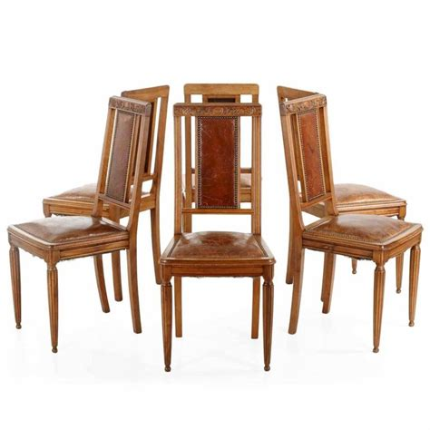 art deco dining table and six chairs at 1stdibs art deco carved walnut dining table with six leather