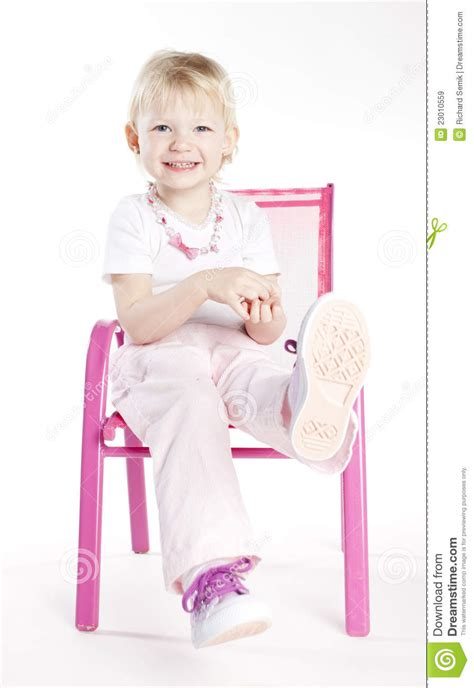 little girl on chair little girl sitting on chair stock image image 23010559