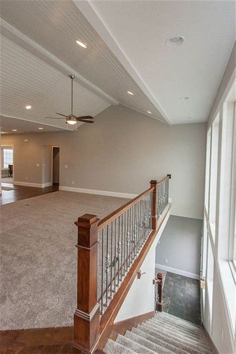 open staircase to basement open concept staircase to basement with wall of windows
