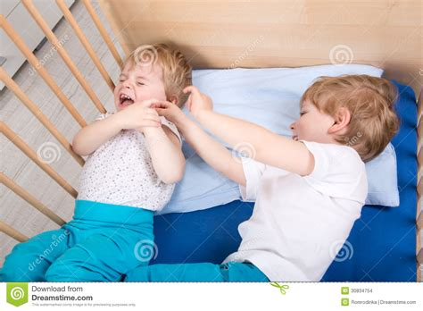 fun in bed two siblings boys having fun in bed stock images image