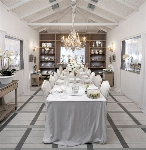 an all white dining room captures the festive winter magic