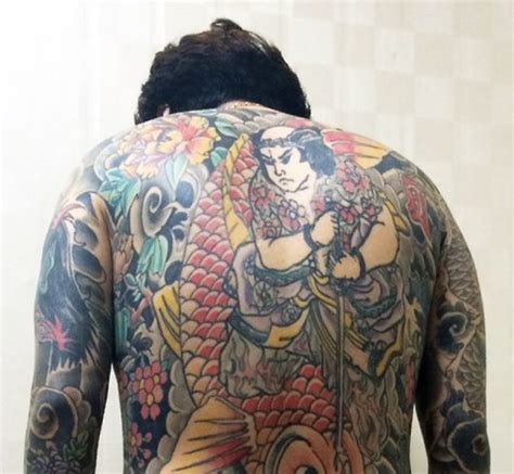 legal tattoo age in korea man tattoos his entire body to avoid korean mandatory