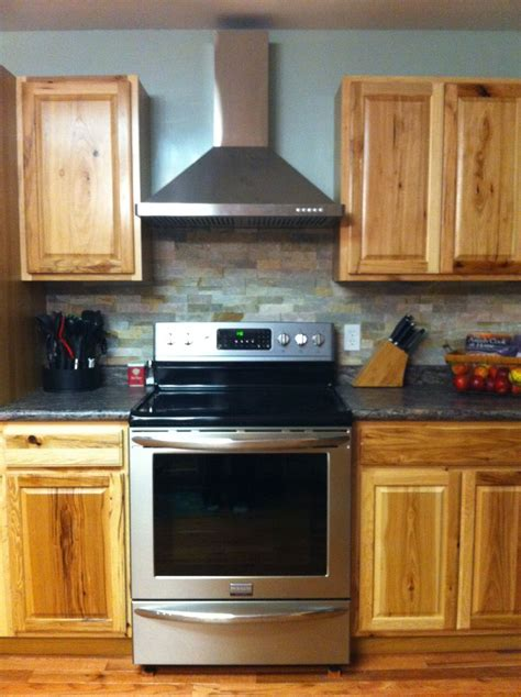 kz kitchen cabinet stone stacked stone backsplash with hickory cabinets and