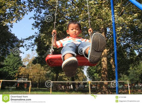 japan swing japanese boy on a swing stock photo image 47191398