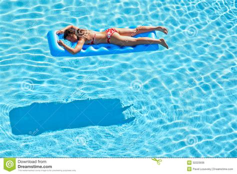 Mattress In Pool by In Swimsuit Bakes Lying On Mattress