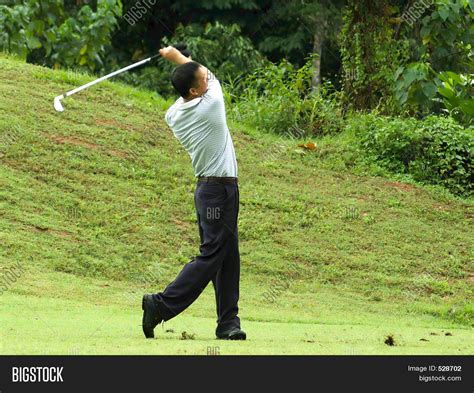 swing stock golfer in full swing stock photo stock images bigstock