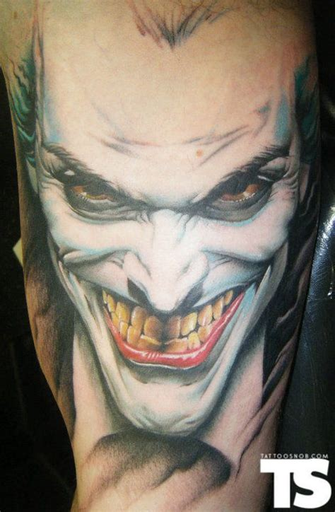 jokers tattoo 20 coolest comic book inspired tattoos 19 the joker