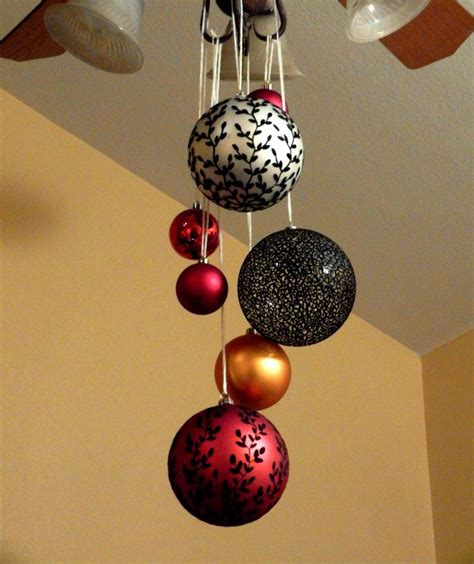 christmas ceiling fan decorating ideas one of our family s decorating ideas hang large ornaments from ceiling fans or
