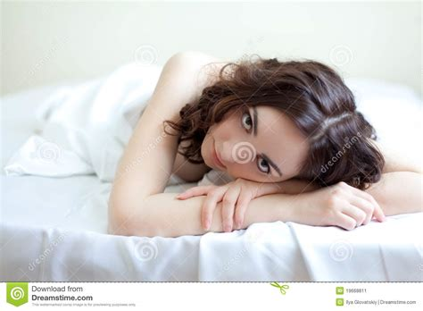 how to look sexier in bed beautiful woman lying in bed stock image image 19668811