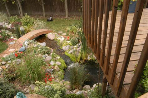 Spell Backyard by Why Every Deck Needs A Pond Aquascape Inc