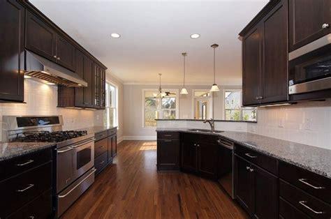 dark kitchen cabinets with backsplash dark kitchen cabinets white subway tile backsplash