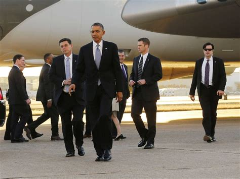 the secret service secret service checking into report armed man was allowed on elevator with obama business