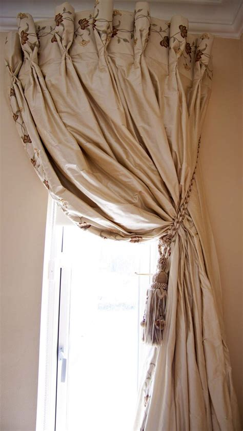 side curtains embroidery at top and along side curved curtain rod very