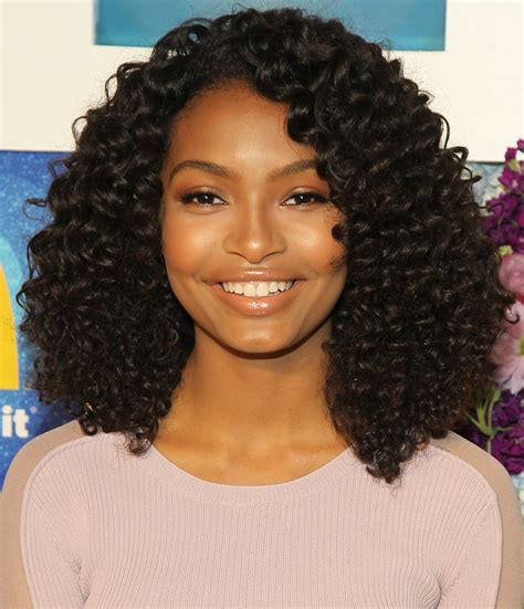 blackish casts hair styles yara shahidi puts her own spin on the double bun hairstyle