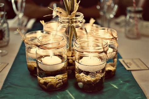 wedding centerpieces with jars and candles jar centerpieces pint jars pebbles floating candle and rafia wedding ideas