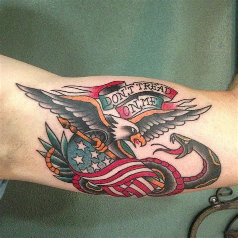 eagle tattoo inner bicep don t tread on me banner and flying eagle tattoo on bicep