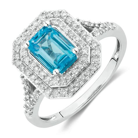 ring with blue topaz 1 2 carat tw of diamonds in 10ct