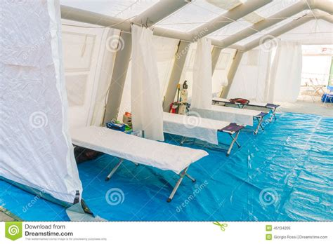 white rescue white rescue centre tent with c bed and emergency equ stock photo image