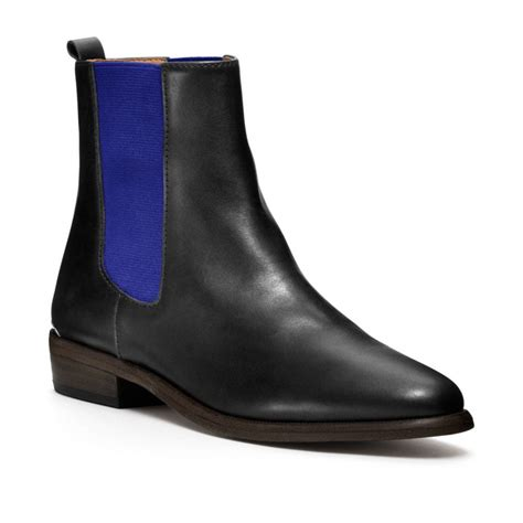 couch boots coach lucia ankle boot in black black cobalt lyst